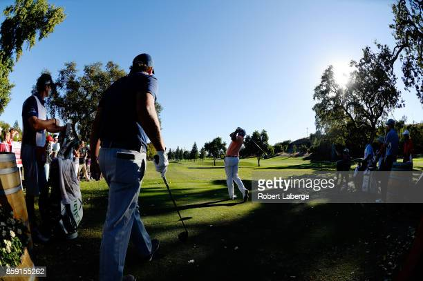 Bill Haas plays his shot from the 16th tee as Phil Mickelson looks on during the final round of the Safeway Open at the North Course of the Silverado...