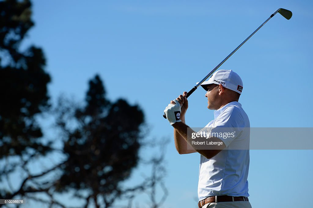 <a gi-track='captionPersonalityLinkClicked' href=/galleries/search?phrase=Bill+Haas&family=editorial&specificpeople=646978 ng-click='$event.stopPropagation()'>Bill Haas</a> plays his tee shot on the fifth hole during the final round of the AT&T Pebble Beach National Pro-Am at the Pebble Beach Golf Links on February 14, 2016 in Pebble Beach, California.