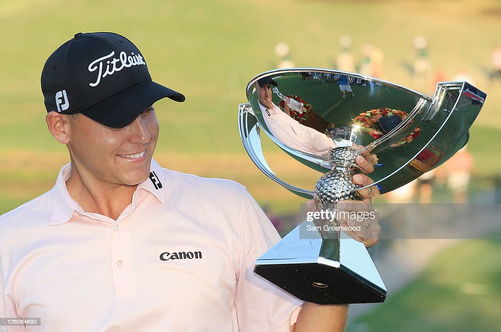 <a gi-track='captionPersonalityLinkClicked' href=/galleries/search?phrase=Bill+Haas&family=editorial&specificpeople=646978 ng-click='$event.stopPropagation()'>Bill Haas</a> poses on the 18th green after winning both the FedExCup and the TOUR Championship after the final round of the TOUR Championship at East Lake Golf Club on September 25, 2011 in Atlanta, Georgia.