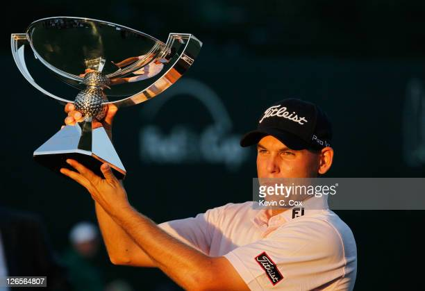 Bill Haas poses on the 18th green after winning both the FedExCup and the TOUR Championship after the final round of the TOUR Championship at East...