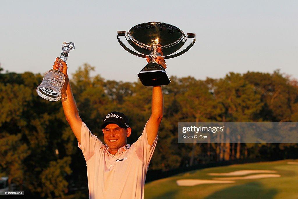 <a gi-track='captionPersonalityLinkClicked' href=/galleries/search?phrase=Bill+Haas&family=editorial&specificpeople=646978 ng-click='$event.stopPropagation()'>Bill Haas</a> poses on the 18th green after winning won both the TOUR Championship and the FedExCup after the final round of the TOUR Championship at East Lake Golf Club on September 25, 2011 in Atlanta, Georgia.