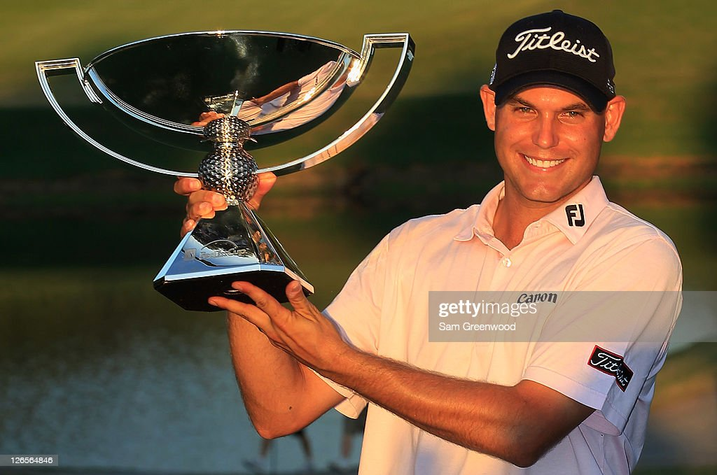 <a gi-track='captionPersonalityLinkClicked' href=/galleries/search?phrase=Bill+Haas&family=editorial&specificpeople=646978 ng-click='$event.stopPropagation()'>Bill Haas</a> poses on the 18th green with the FedExCup after winning both the FedExCup and the TOUR Championship after the final round of the TOUR Championship at East Lake Golf Club on September 25, 2011 in Atlanta, Georgia.