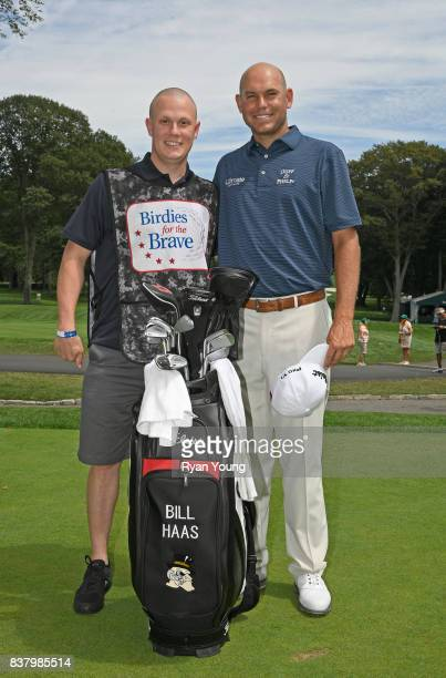 Bill Haas poses with his Military Caddie during practice for the THE NORTHERN TRUST at Glen Oaks Club on August 23 in Old Westbury New York