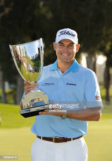 Bill Haas poses with the tournament trophy after winning the Northern Trust Open at Riviera Country Club on February 19 2012 in Pacific Palisades...
