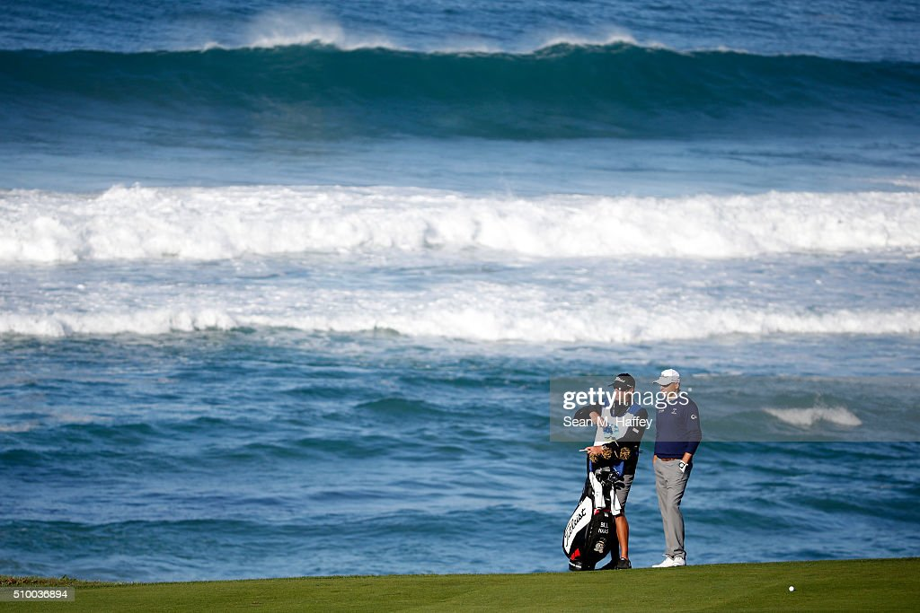 <a gi-track='captionPersonalityLinkClicked' href=/galleries/search?phrase=Bill+Haas&family=editorial&specificpeople=646978 ng-click='$event.stopPropagation()'>Bill Haas</a> prepares to play a shot from the 10th fairway during round three of the AT&T Pebble Beach National Pro-Am at the Pebble Beach Golf Links on February 13, 2016 in Pebble Beach, California.