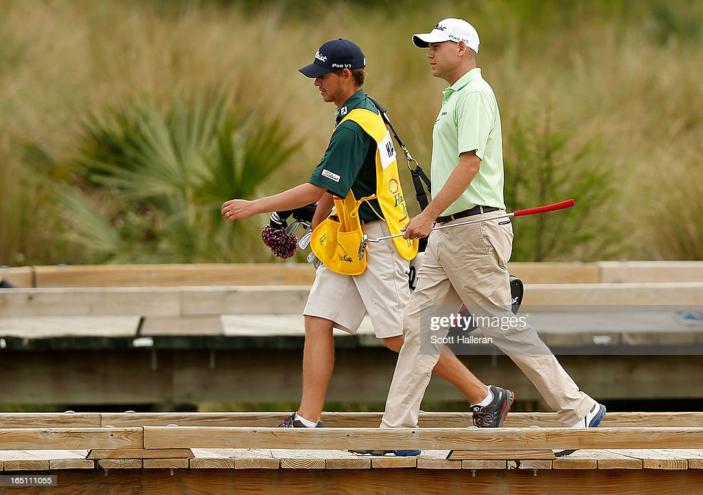 Bill Haas walks on the 17th hole with his brother/ caddie Jay during the third round of the Shell Houston Open at the Redstone Golf Club on March 30, 2013 in Humble, Texas.