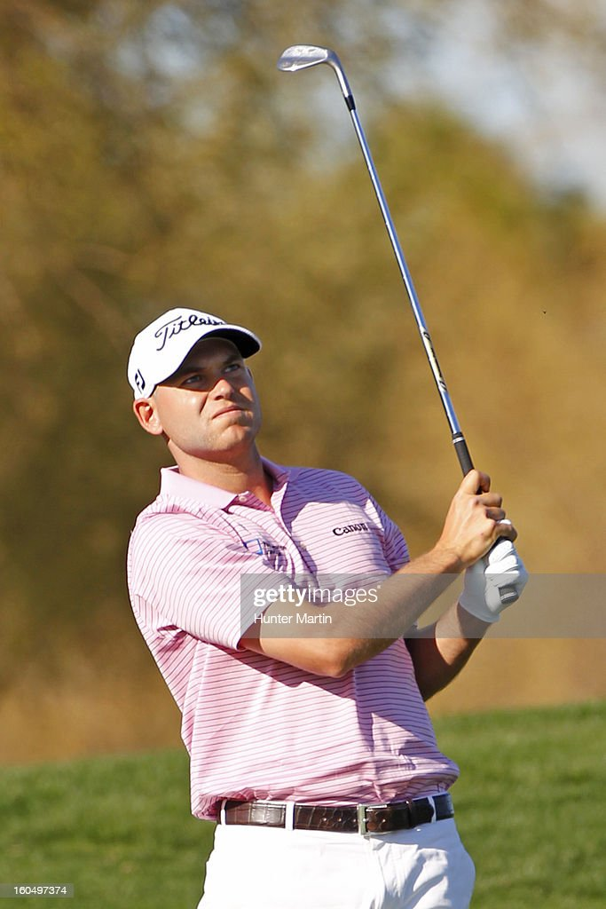 <a gi-track='captionPersonalityLinkClicked' href=/galleries/search?phrase=Bill+Haas&family=editorial&specificpeople=646978 ng-click='$event.stopPropagation()'>Bill Haas</a> watches his second shot on the second hole during the second round of the Waste Management Phoenix Open at TPC Scottsdale on February 1, 2013 in Scottsdale, Arizona.