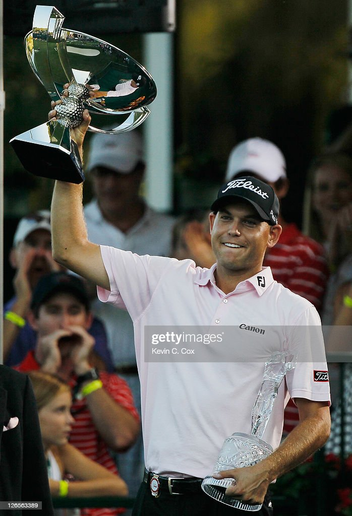 <a gi-track='captionPersonalityLinkClicked' href=/galleries/search?phrase=Bill+Haas&family=editorial&specificpeople=646978 ng-click='$event.stopPropagation()'>Bill Haas</a> waves to the gallery on the 18th green after winning both the FedExCup and the TOUR Championship after the final round of the TOUR Championship at East Lake Golf Club on September 25, 2011 in Atlanta, Georgia.