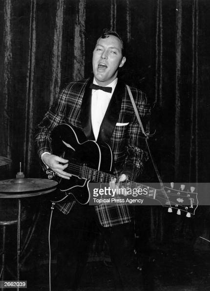 Bill Haley American rock 'n' roll singer and guitarist playing and singing during rehearsals at the Dominion Theatre London Original Publication...