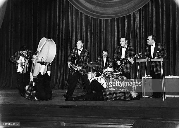 Bill Haley And His Comets perform on stage Johnny Grande Al Rex Bill Haley Ralph Jones Rudy Pompilli Franny Beecher Billy Williamson 6 February 1957