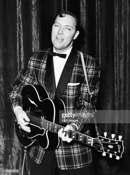 Bill Haley posed with Gibson guitar wearing check jacket 6 February 1957