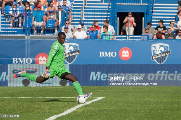 Bill Hamid of the DC United kicks the ball against the Montreal Impact during the MLS match at Saputo Stadium on August 25 2012 in Montreal Quebec...