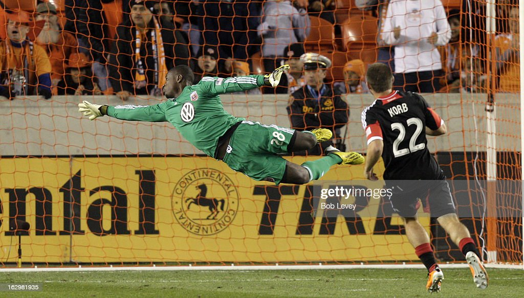 Bill Hamid #28 of the D.C. United makes a diving attempt at a ball that went wide as Chris Korb #22 of the D.C. United looks on against the Houston Dynamo during first half action at BBVA Compass Stadium on March 2, 2013 in Houston, Texas.