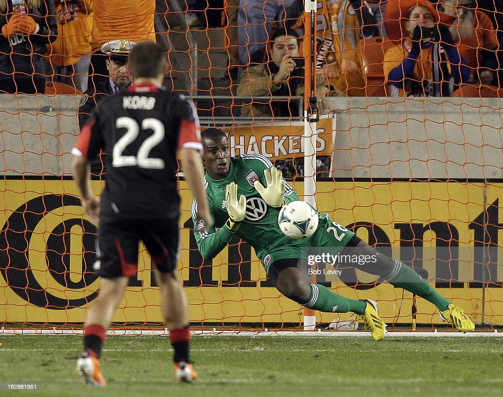 Bill Hamid #28 of the D.C. United makes a stop on a penalty kick by Brad Davis #11 of the Houston Dynamo during first half action at BBVA Compass Stadium on March 2, 2013 in Houston, Texas.