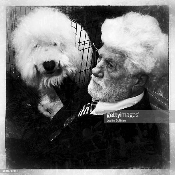 Bill Harrington sits with his Old English Sheepdog named Swagger during the 138th annual Westminster Dog Show at Madison Square Garden on February 10...