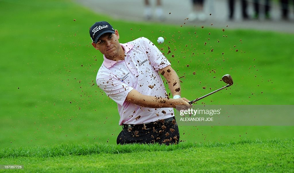 Bill Hass of the United States gets out of a bunker on the 4th hole on December 02 ,2012 during the 2012 Nedbank Golf Challenge in Sun City.