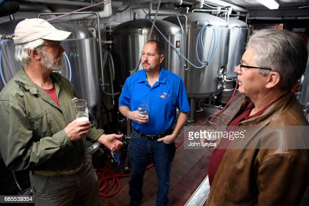 Bill Hasse Mike Miller Lead Brewmaster and Warren Quilliam talk beer in the tasting room at the Sandlot Brewery The tie between beer and baseball and...