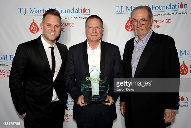 Bill Hearn accepts the Frances Preston Lifetime Music Industry Achievement Award on behalf of his father Billy Ray Hearn along with Matthew West and...