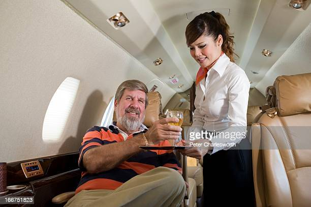 Bill Heinecke an American who has lived in Asia for most of his life and has taken Thai citizenship sits inside his company jet at Bangkok's second...