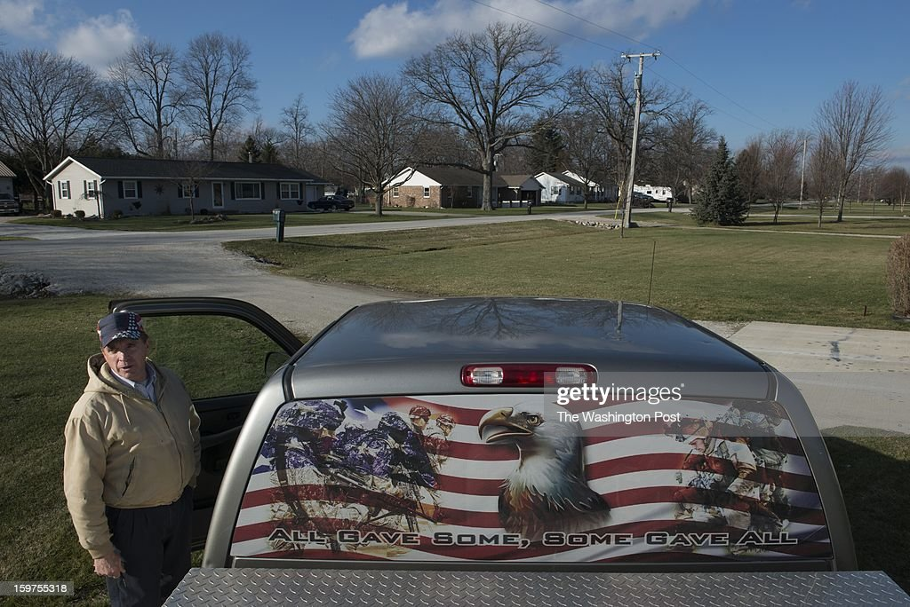 Bill Herr pauses beside his truck in front of his home in Fremont, Ohio on January 17. Herr's truck has a custom designed emblem -- a father's day gift from his daughter -- that bears a saying he likes: 'All gave some, some gave all.' Herr served in Iraq.