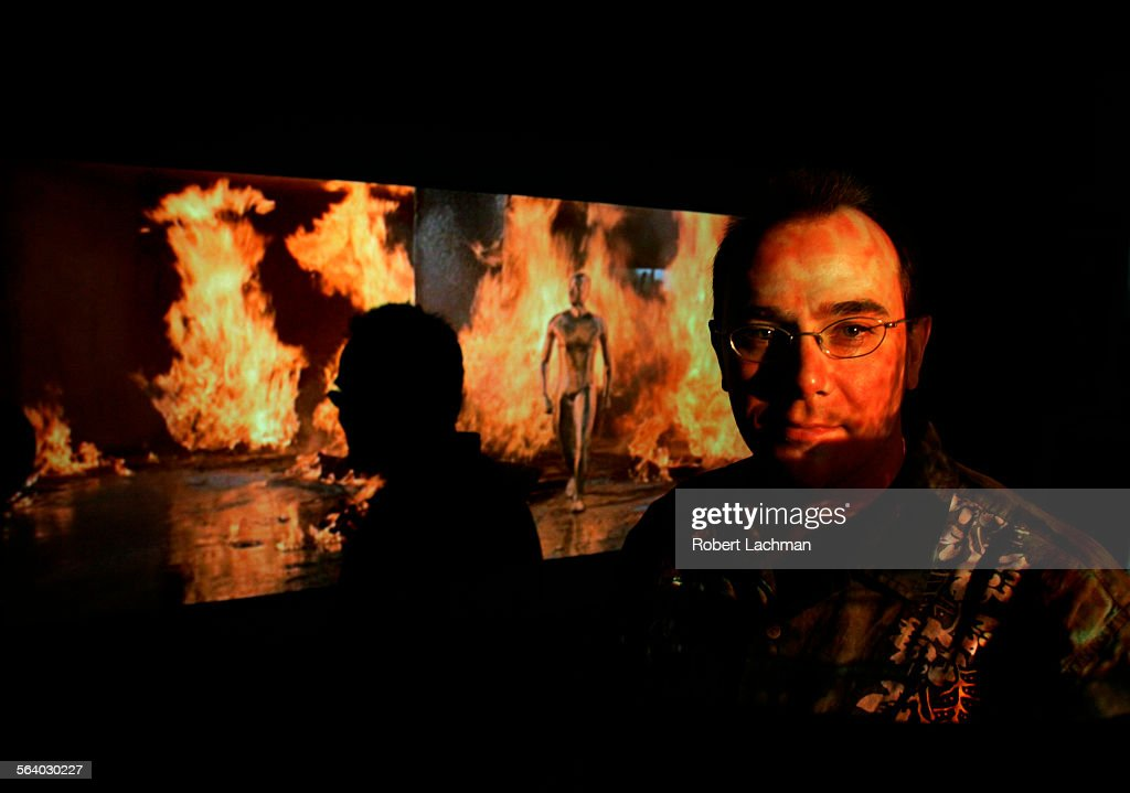 Bill Hunt is photographed in front of his projection screen with a scene from Terminator2 from a Blu–ray format disc at his Irvine home on June 28...
