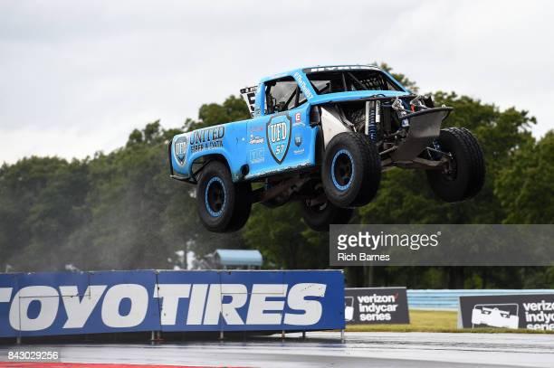 Bill Hynes goes over a jump during the SPEED Energy Stadium Super Trucks Race at Watkins Glen International on September 3 2017 in Watkins Glen New...