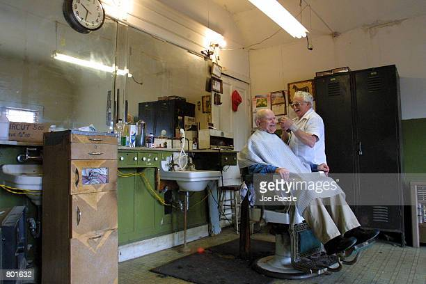 Bill Jaynes receives a haircut April 13 2001 from Bill Sparkman who has been a barber for 41 years in Crawford Texas Crawford the hometown of US...