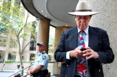 Bill Johnstone a lone protester leaves the Intercontinental Hotel after being released by police during the G20 Finance Ministers and Central Bank...