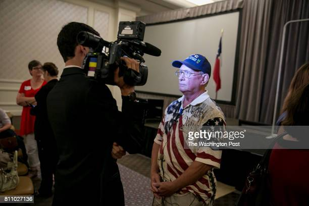 Bill Kelberlau of Georgetown Texas speaks with a reporter after the town hall event Senator Ted Cruz spoke at a Defend and Reform town hall with...