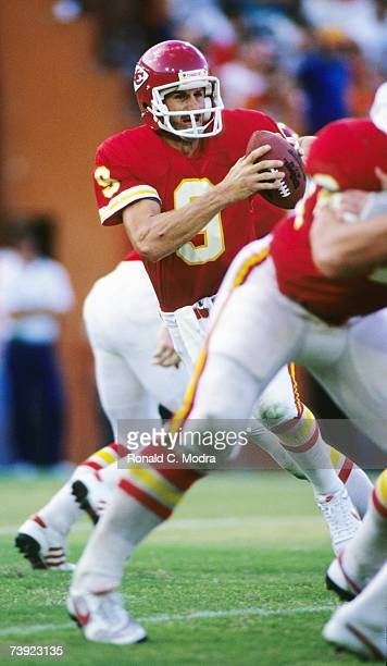 Bill Kenney of the Kansas City Chiefs goes back to pass during a game in September 1985 in Kansas City Missouri