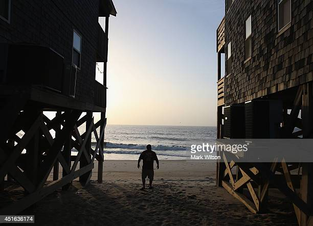 Bill Kirk of Ashland Ky takes one last look at the ocean in front of the beach house he rented before complying with the mandatory evacuation orders...
