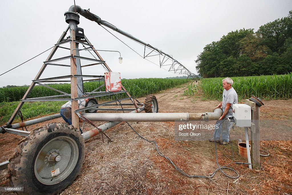 Bill Kirklin connects an irrigation system in his cornfield on July 20, 2012 near Whiteland, Indiana. Kirklin and his brother Jud Vaught, who are 6th generation Indiana farmers, raise about 1,500 acres of corn and soybeans on a farm founded by their family in 1835. The corn and soybean belt in the middle of the nation is experiencing one of the worst droughts in more than five decades. Indiana was the nation's fourth largest corn producer in 2011.