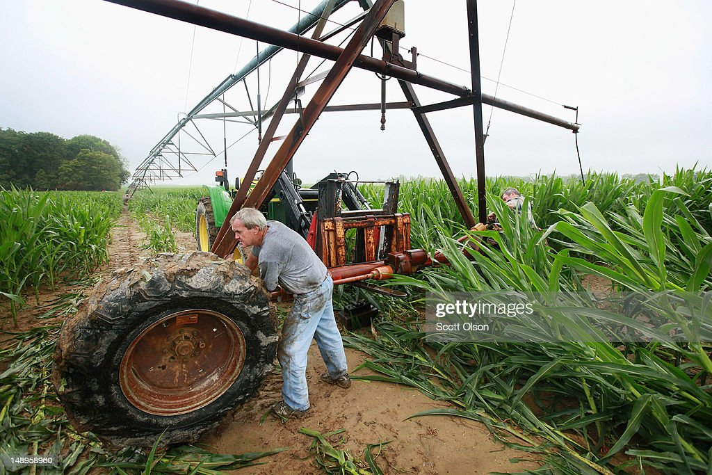 Bill Kirklin sets up an irrigation system in his cornfield on July 20, 2012 near Whiteland, Indiana. Kirklin and his brother Jud Vaught, who are 6th generation Indiana farmers, raise about 1,500 acres of corn and soybeans on a farm founded by their family in 1835. The corn and soybean belt in the middle of the nation is experiencing one of the worst droughts in more than five decades. Indiana was the nation's fourth largest corn producer in 2011.