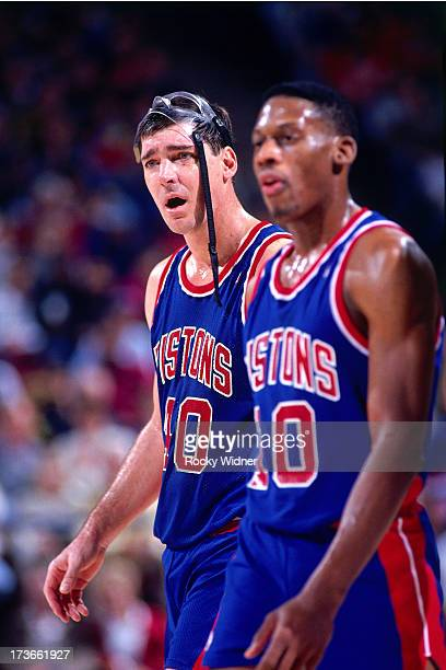 Bill Laimbeer and Dennis Rodman of the Detroit Pistons react to a call during a game against the Sacramento Kings played on December 8 1990 at Arco...