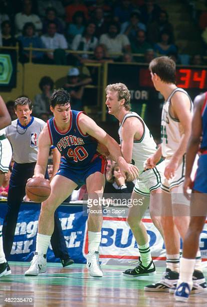 Bill Laimbeer of the Detroit Pistons backs in on Larry Bird of the Boston Celtics during an NBA basketball game circa 1985 at the Boston Garden in...