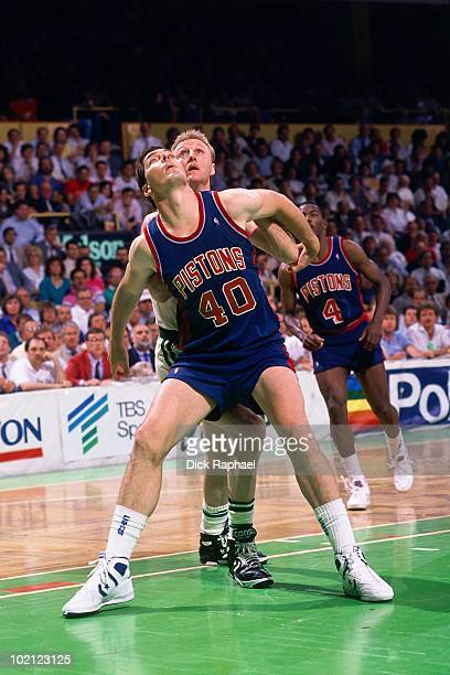 Bill Laimbeer of the Detroit Pistons boxes out against Larry Bird of the Boston Celtics during a game played in 1987 at the Boston Garden in Boston...