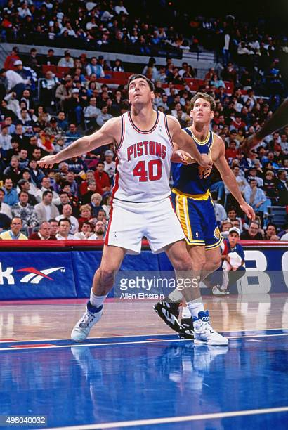 Bill Laimbeer of the Detroit Pistons boxes out against the Golden State Warriors circa 1990 at the Palace of Auburn Hills in Auburn Hills Michigan...