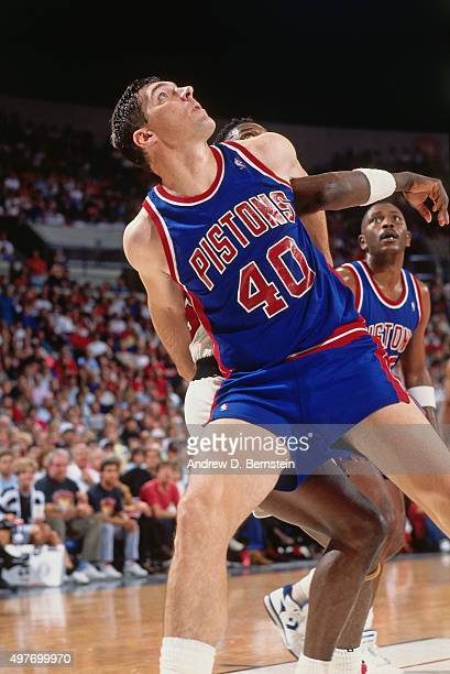 Bill Laimbeer of the Detroit Pistons boxes out against the Portland Trail Blazers circa 1989 at Veterans Memorial Coliseum in Portland Oregon NOTE TO...