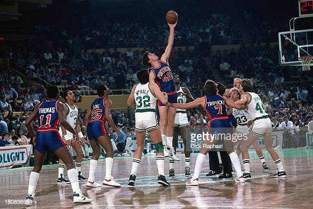 BIll Laimbeer of the Detroit Pistons controls the ball after a jump ball during a game against the Boston Celtics circa 1986 at the Boston Garden in...