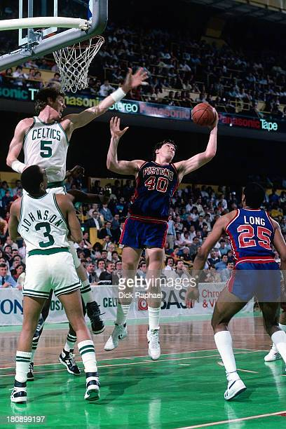 Bill Laimbeer of the Detroit Pistons grabs a rebound against Bill Walton of the Boston Celtics during a game circa 1986 at the Boston Garden in...