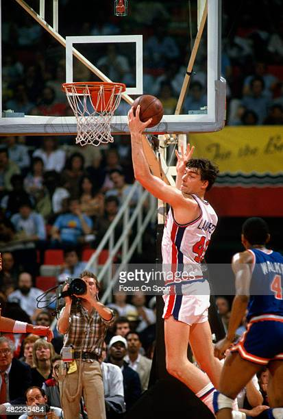 Bill Laimbeer of the Detroit Pistons grabs a rebound against the New York Knicks during an NBA basketball game circa 1985 at the Pontiac Silverdome...