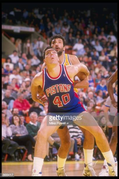 Bill Laimbeer of the Detroit Pistons looks for the ball during a game Mandatory Credit Mike Powell /Allsport Mandatory Credit Mike Powell /Allsport
