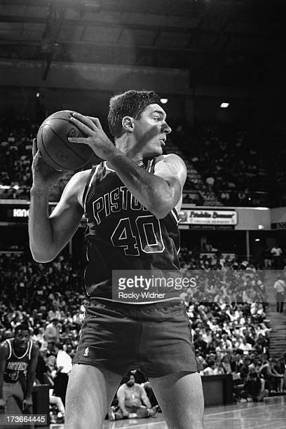 Bill Laimbeer of the Detroit Pistons looks to pass the ball against the Sacramento Kings during a game played on November 28 1989 at Arco Arena in...