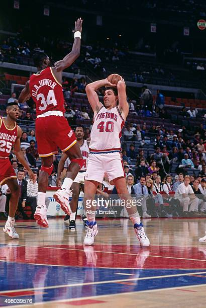 Bill Laimbeer of the Detroit Pistons passes the ball against the Houston Rockets circa 1990 at the Palace of Auburn Hills in Auburn Hills Michigan...