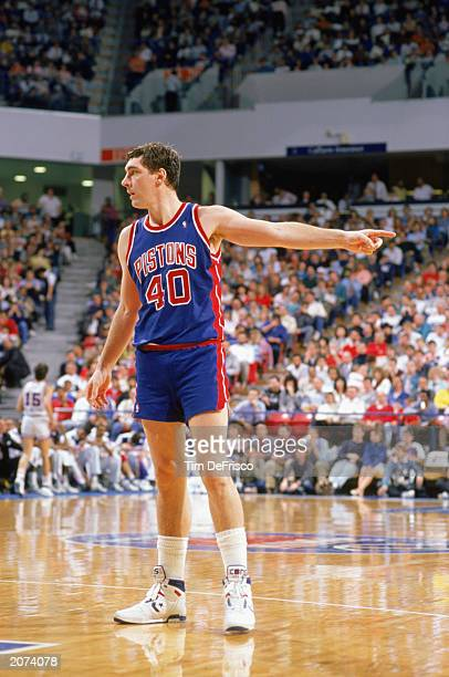 Bill Laimbeer of the Detroit Pistons points during a game against the Sacramento Kings at Arco Arena in Sacramento California in the 19881989 NBA...
