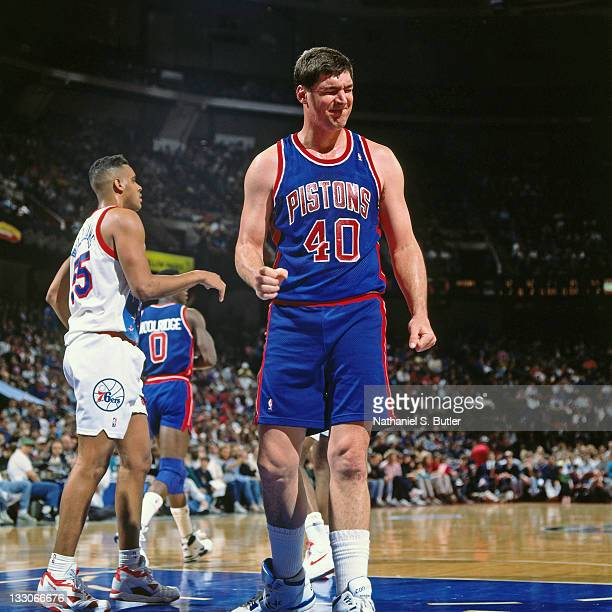 Bill Laimbeer of the Detroit Pistons reacts against the Philadelphia 76ers circa 1991 at the Spectrum in Philadelphia Pennsylvania NOTE TO USER User...