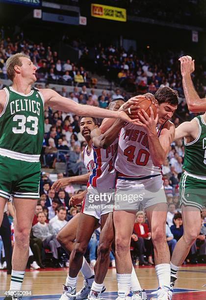 Bill Laimbeer of the Detroit Pistons rebounds against the Boston Celtics circa 1990 at the Palace of Auburn Hills in Auburn Hills Michigan NOTE TO...