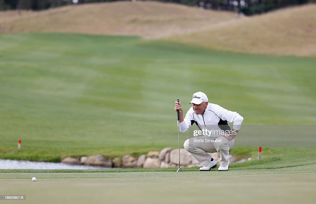 Bill Longmuir of Scottland lines up a putt during the final round on day three of the WINSTONgolf Senior Open played at WINSTONgolf on September 8, 2013 in Schwerin, Germany.