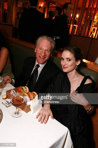 Bill Maher and Winona Ryder during 2006 Vanity Fair Oscar Party Hosted by Graydon Carter at Morton's in Beverly Hills California United States