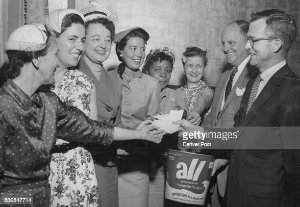 Bill Mathews of Monsanto Chemical Co presents certificates awarding Westinghouse clothes dryers to six of eight women in this area who competed...